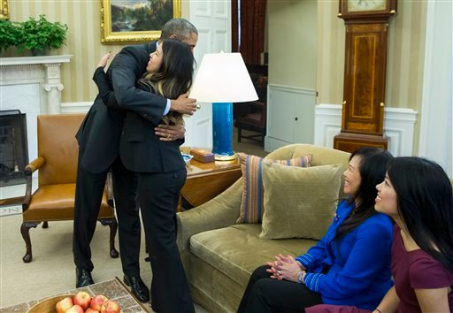 President Barack Obama hugs Ebola survivor Nina Pham in the Oval Office of the White House in Washington, Friday, Oct. 24, 2014, in Washington.