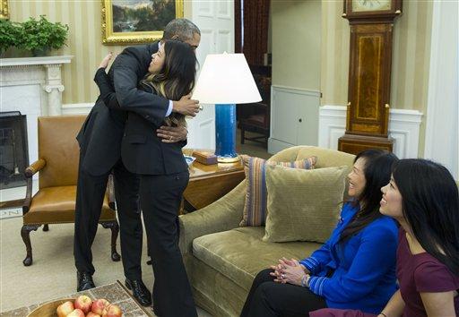 President Barack Obama hugs Ebola survivor Nina Pham in the Oval Office of the White House in Washington, Friday, Oct. 24, 2014, in Washington.