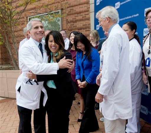 Patient Nina Pham is hugged by Dr. Anthony Fauci, director of the National Institute of Allergy and Infectious Diseases outside of National Institutes of Health (NIH) in Bethesda, Md., Friday, Oct. 24, 2014.