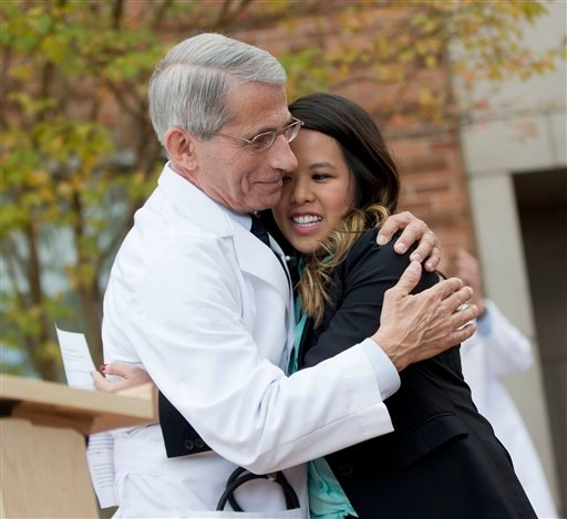 Patient Nina Pham is hugged by Dr. Anthony Fauci, director of the National Institute of Allergy and Infectious Diseases, outside of National Institutes of Health (NIH) in Bethesda, Md., Friday, Oct. 24, 2014.