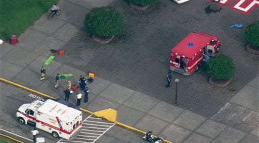 This image made from a video provided by KOMO shows emergency personnel responding after reports of a shooting at Marysville-Pilchuck High School in Marysville, Wash., Friday, Oct. 24, 2014. (AP Photo/KOMONews.com)