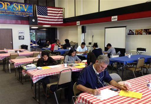 This Monday, Oct. 20, 2014 photo shows Democratic Party volunteers call prospective voters to urge them to support Gov. Jerry Brown and other party candidates at a phone bank in the Van Nuys neighborhood of Los Angeles.