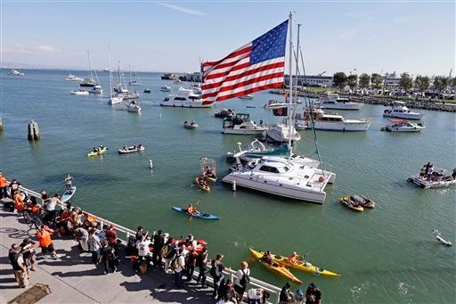 This Oct. 24, 2014, file photo shows boats in McCovey Cove outside AT&T Park before Game 3 of baseball's World Series between the Kansas City Royals and the San Francisco Giants in San Francisco.