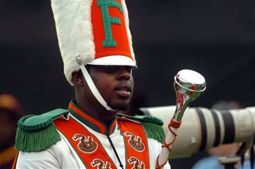 In this Nov. 19, 2011 file photo, Robert Champion, a drum major in Florida A&M University's Marching 100 band, performs during halftime of a football game in Orlando, Fla.