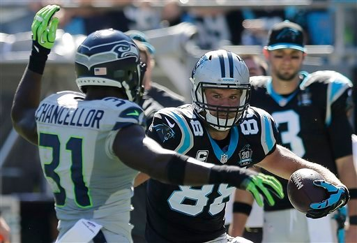 Carolina Panthers tight end Greg Olsen (88) works against Seattle Seahawks strong safety Kam Chancellor (31) during the first half of an NFL football game, Sunday, Oct. 26, 2014, in Charlotte. (AP Photo/Chuck Burton)