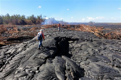 Officials say the lava advanced nearly 460 yards from Thursday morning to Friday, Oct. 24, 2014. (AP Photo/U.S. Geological Survey)