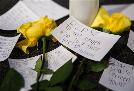 Messages of support on the stage near candles and flowers in between morning services at The Grove Church in Marysville, Wash., two days after the Marysville-Pilchuck High School shooting, on Sunday, Oct. 26, 2014.