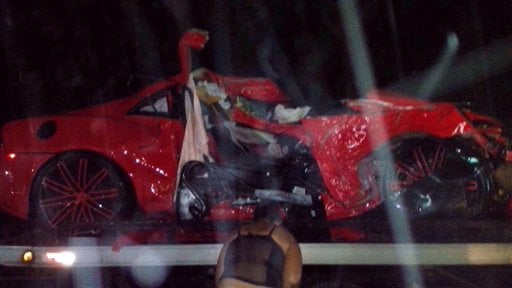 In this handout photo provided by the Metropolitan Transportation Agency shows the heavily damaged vehicle in which Dominican baseball player Oscar Taveras was killed along with a young woman passenger, near the city of Puerto Plata, Dominican Republic.