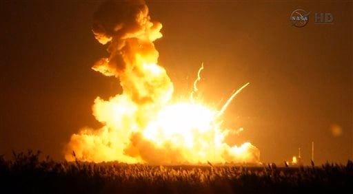 This image taken from video provided by NASA TV shows Orbital Sciences Corp.'s unmanned rocket blowing up over the launch complex at Wallops Island, Va., just six seconds after liftoff. (AP Photo/NASA TV)