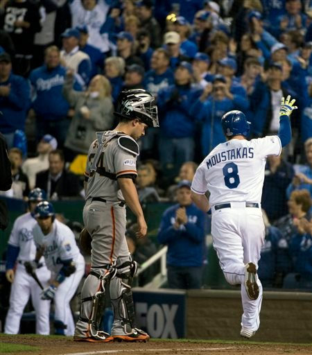 Royals Mike Moustakas crosses home plate after hitting a solo home run off Giants relief pitcher Hunter Strickland in the bottom of the sixth inning of Game 6 of baseball's World Series Oct. 28, 2014. (AP Photo/The Sacramento Bee, Jose Luis Villegas)