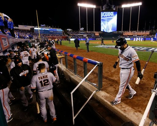 San Francisco Giants Gregor Blanco, right, walks back to the dugout after being struck out by Kansas City Royals pitcher Tim Collins to end Game 6 of baseball's World Series Oct. 28, 2014, in Kansas City, Mo. (AP Photo/Matt Slocum)