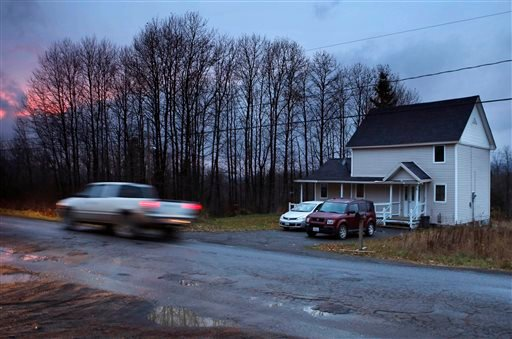 A truck passes the rural home Wednesday, Oct. 29, 2014, in Fort Kent, Maine, where Kaci Hickox, a nurse who treated Ebola patients in West Africa, is staying. (AP)