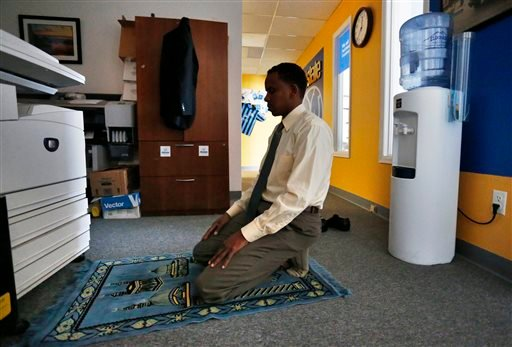 Somali-American Ahmed Odowaay, who works as a community advocate and professional translator, makes his midday prayer inside an office used by the Colorado Muslim Council, in Aurora, Colo., Wednesday, Oct. 29, 2014. (AP)