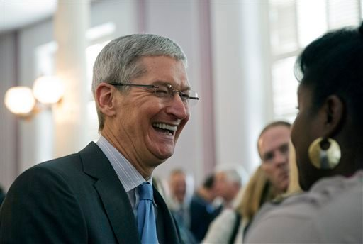 Apple chief executive and Alabama native Tim Cook laughs with a group before an Alabama Academy of Honor ceremony at the state Capitol in this Oct. 27, 2014 file photo taken in Montgomery, Ala. (AP Photo/Brynn Anderson, File)