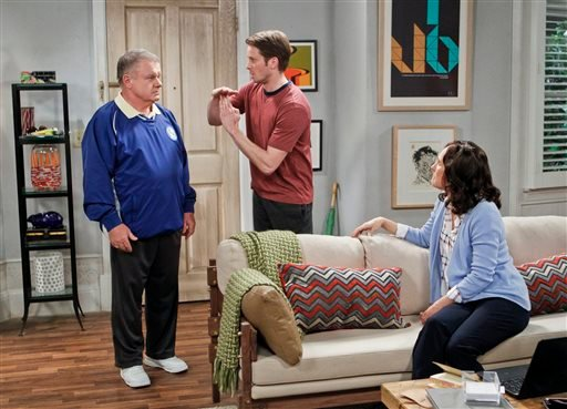 """2014 photo provided by CBS shows: left, Jack McGee as Arthur, Tyler Ritter as Ronny and Laurie Metcalf as Marjorie, in the pilot for the CBS comedy, """"The McCarthys,"""" premiering Oct. 30, 2014 (9:30-10:00 PM, ET/PT) on CBS. (AP Photo/CBS, Sonja Flemming)"""