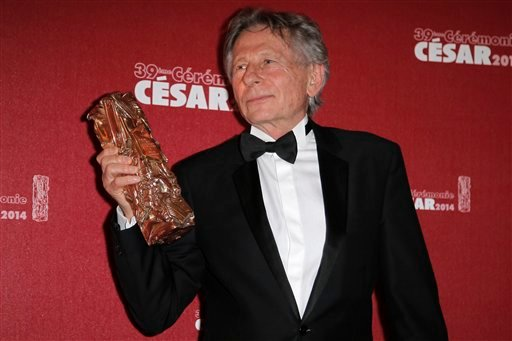 FILE - In this Feb. 28, 2014 file photo Polish-French film director Roman Polanski holds his best director award during the 39th French Cesar Awards Ceremony in Paris Feb. 28, 2014. (AP Photo/Lionel Cironneau, File)