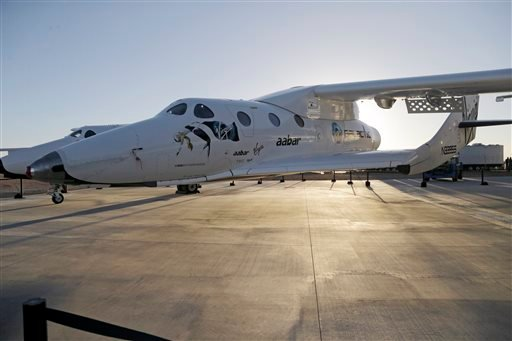In this Sept. 25, 2013, file photo, shows Virgin Galactic's SpaceShipTwo at a Virgin Galactic hangar at Mojave Air and Space Port in Mojave, Calif.