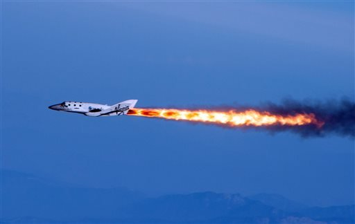 In this April 29, 2013 file photo provided by Virgin Galactic shows Virgin Galactic's SpaceShipTwo under rocket power, over Mojave, Calif.