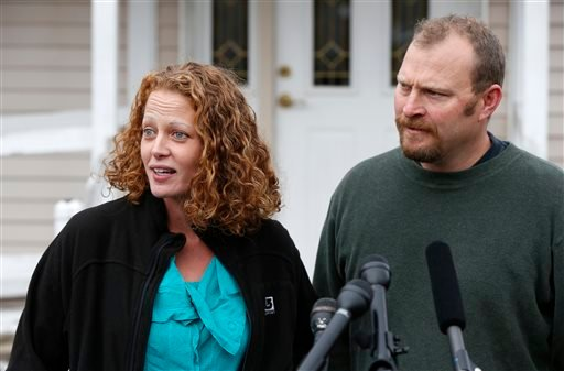 Nurse Kaci Hickox is accompanied by her boyfriend Ted Wilbur as she speaks to reporters outside their home, Friday, Oct. 31, 2014, in Fort Kent, Maine. (AP)