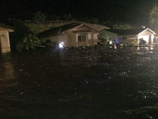 This image provided by the Ventura County Fire Department shows a home on San Como Lane in Camarillo Calif., inundated by mud and debris from a hillside early Saturday Nov. 1, 2014.  (AP Photo/Ventura County Fire Department, Capt. Mike Lindbery)