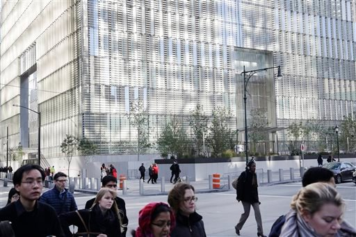 People walk past One World Trade Center, Monday, Nov. 3, 2014, in New York. (AP)