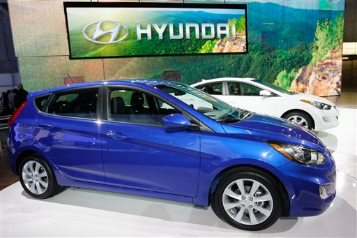 FILE - This April 20, 2011 file photo shows the Hyundai Accent, foreground, and Elantra on display at the New York International Auto Show, in New York.