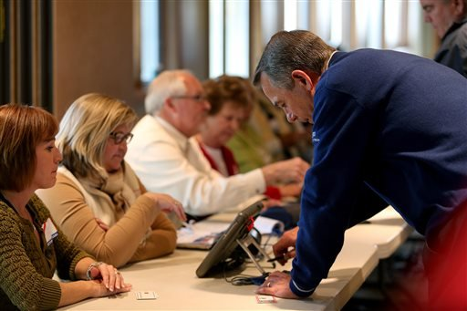 U.S. House Speaker John Boehner signs in before voting at VOA Park in West Chester, Ohio on Election Day, Tuesday, Nov. 4, 2014. (AP Photo/The Cincinnati Enquirer, Cara Owsley)