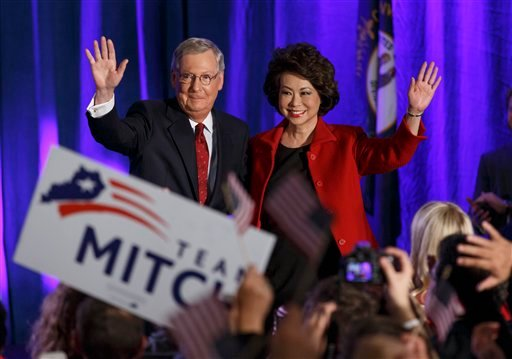 Senate Minority Leader Mitch McConnell of Ky., joined by his wife, former Labor Secretary Elaine Chao, celebrates with his supporters at an election night party in Louisville, Ky.,Tuesday, Nov. 4, 2014. (AP)
