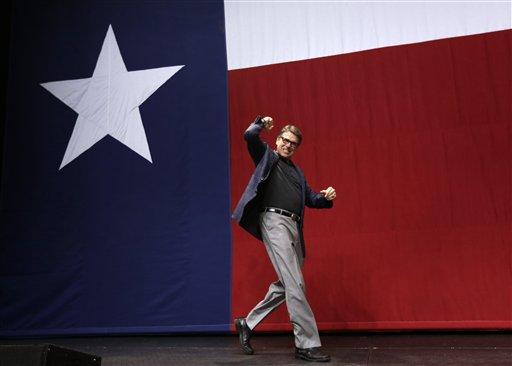 Texas Governor Rick Perry takes the stage Tuesday, Nov. 4, 2014, in Austin, Texas. (AP Photo/David J. Phillip)