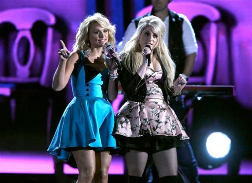Miranda Lambert, left, and Meghan Trainor perform onstage at the 48th annual CMA Awards at the Bridgestone Arena on Wednesday, Nov. 5, 2014, in Nashville, Tenn. (Photo by Wade Payne/Invision/AP)