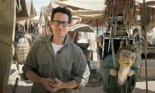 "In this video grab made available by Lucasfilm Ltd. & TM on Thursday, May 22, 2014, J.J. Abrams, director of ""Star Wars: Episode VII,"" talks to the fans from the movie set in the desert in Abu Dhabi, United Arab Emirates."