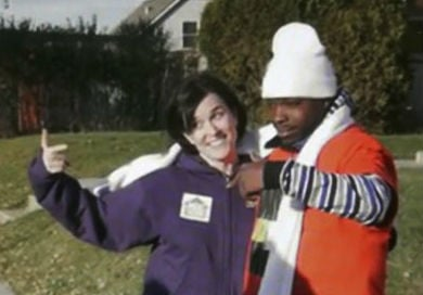 In this image made from a video released by Neighborhoods Organizing for Change, Minneapolis Mayor Betsy Hodges and Neighborhoods Organizing for Change employee Navell Gordon gesture while they knock on doors to get out the vote. (AP)