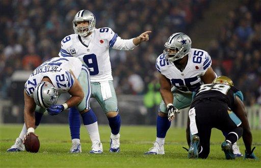 Dallas Cowboys quarterback Tony Romo (9) makes a call against the Jacksonville Jaguars during the NFL football game at Wembley Stadium, London, Sunday, Nov. 9, 2014. (AP Photo/Matt Dunham)