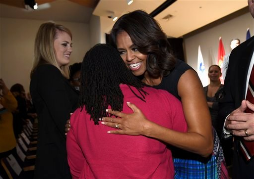 First lady Michelle Obama greets people after speaking at the Women Veterans Career Development Forum at the Women in Military Service for America Memorial (WIMSA) at Arlington National Cemetery in Arlington, Va., Monday, Nov. 10, 2014. (AP Photo)