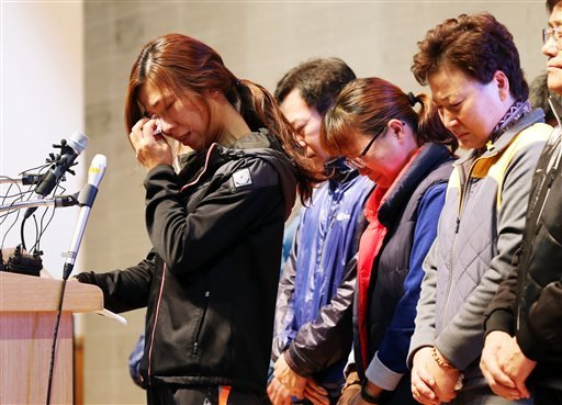 Relatives of the nine missing passengers of the sunken ferry Sewol cry during a news conference at a gym on South Korea's southwestern island of Jindo.