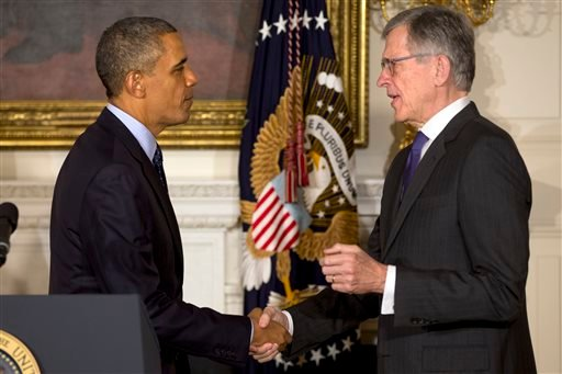 FILE - In this May 1, 2013 file photo, President Barack Obama shakes hands with then nominee for Federal Communications Commission, Tom Wheeler, in the State Dining Room of the White House in Washington. (AP)