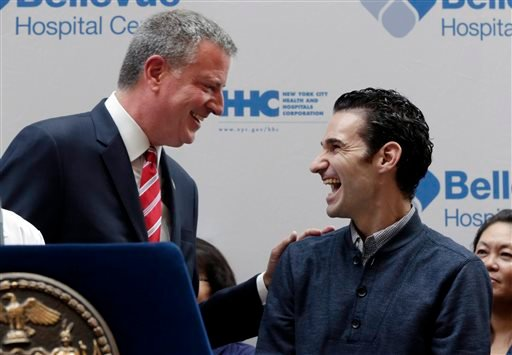 Dr. Craig Spencer, right, who was the first Ebola patient in New York City, and New York Mayor Bill de Blasio laugh during a news conference New York's Bellevue Hospital, Tuesday, Nov. 11, 2014. (AP)