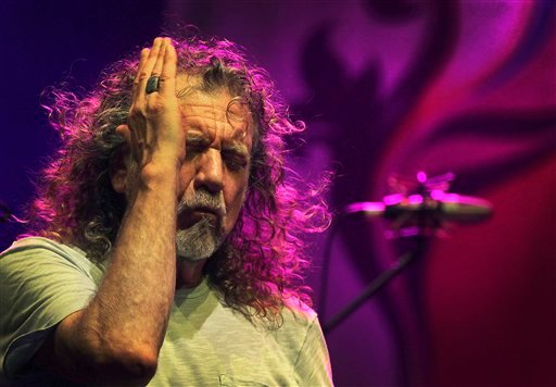 In this file photo dated Thursday March 21, 2013, Robert Plant, lead vocalist and lyricist of the rock band Led Zeppelin, performs during the Timbre Rock and Roots concert in Singapore.