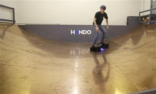 In this Oct. 30, 2014 photo, Arx Pax engineer Garrett Foshay demonstrates riding a Hendo Hoverboard in Los Gatos, Calif.