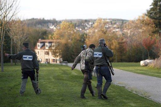Members of the police animal brigade walk through the streets of Montevrain, east of Paris, Thursday Nov. 13, 2014.