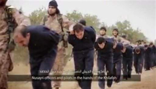 This still image taken from an undated video published on the Internet by the Islamic State group militants and made available, Sunday, Nov. 16, 2014, purports to show extremists marching Syrian soldiers before beheading them. (AP)