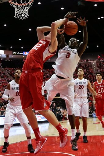 Utah forward Jakob Poeltl is fouled by San Diego State forward Angelo Chol (3) during the first half in an NCAA college basketball game Tuesday, Nov. 18, 2014, in San Diego.