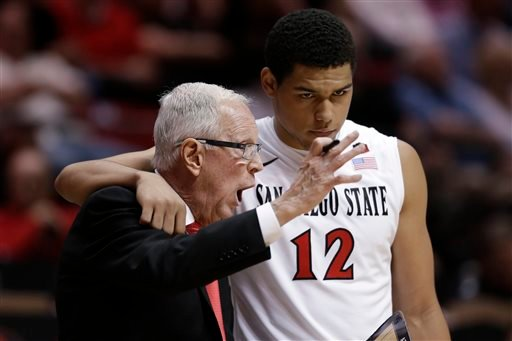San Diego State coach Steve Fisher, left, has a word with guard Trey Kell during the first half in an NCAA college basketball game against Utah on Tuesday, Nov. 18, 2014, in San Diego.