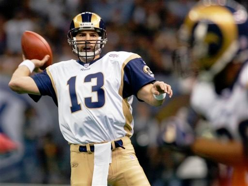 In this Feb. 3, 2002, file photo, St. Louis Rams quarterback Kurt Warner looks to pass to Marshall Faulk in the first quarter against the New England Patriots in Super Bowl XXXVI at the Louisiana Superdome in New Orleans.