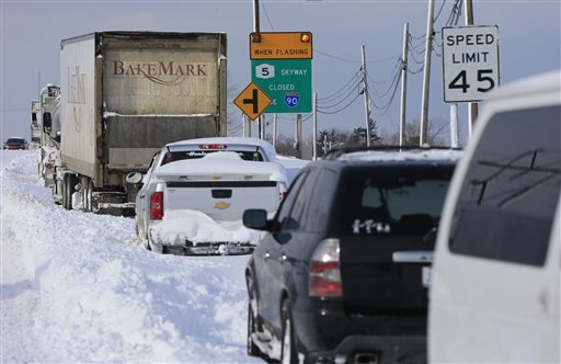 Vehicles sit at a closed New York State Thruway entrance in Hamburg, N.Y. on Wednesday, Nov. 19, 2014. (AP)