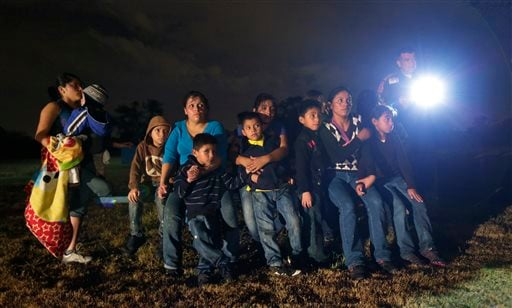 FILE - This June 25, 2014 file photo, shows a group of immigrants from Honduras and El Salvador who crossed the U.S.-Mexico border illegally as they are stopped in Granjeno, Texas. (AP)