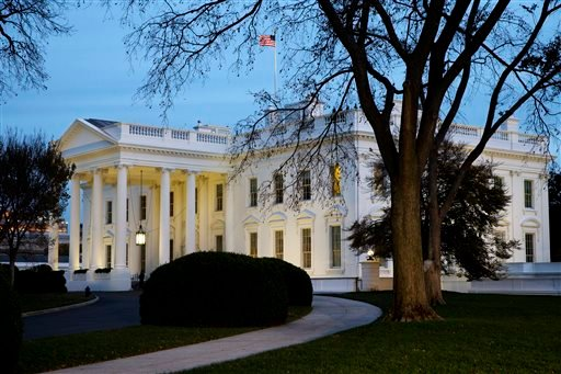 The White House is seen at dusk in Washington, Wednesday, Nov. 19, 2014. (AP)