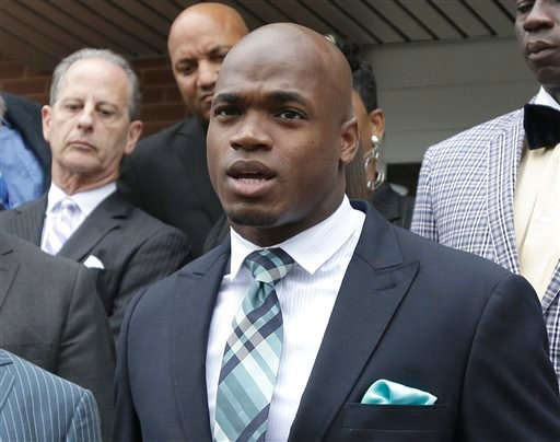 FILE - In this Nov. 4, 2014, file photo, Minnesota Vikings running back Adrian Peterson speaks to the media after pleading no contest to an assault charge in Conroe, Texas. (AP)
