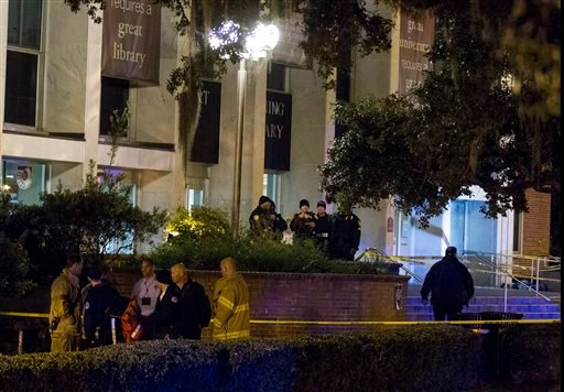 Tallahassee police investigate a shooting outside the Strozier library on the Florida State University campus in Tallahassee, Fla. Thursday Nov 20, 2014. Officers shot and killed the suspected gunman police said. (AP Photo/Mark Wallheiser)