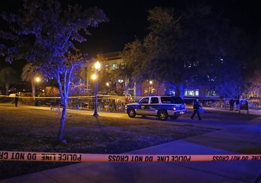 Police investigate a shooting at Strozier Library on Florida State campus on Thursday, Nov. 20, 2014, in Tallahassee, Fla. (AP Photo/Steve Cannon)